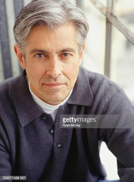 Man sitting outdoors, portrait
