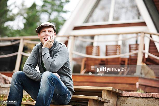 man sitting outside his home - sweden stock pictures, royalty-free photos & images
