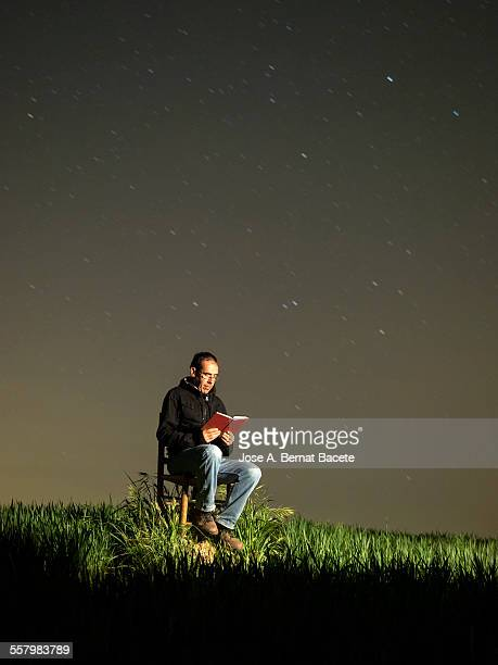 Man sitting reading a book