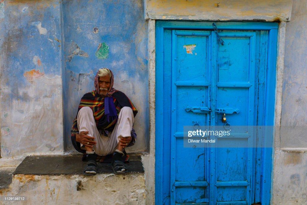 Man sitting roadside at Udaipur : Stock Photo