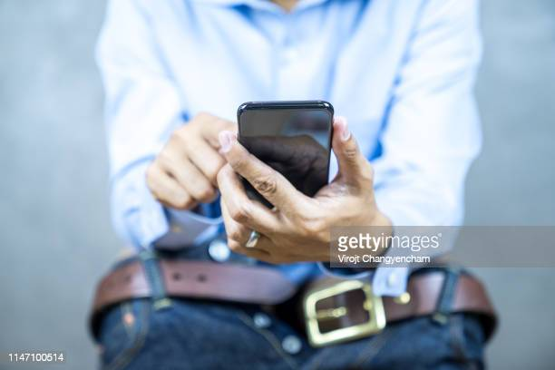 man sitting toilet and holding smartphone - men taking a dump stock pictures, royalty-free photos & images