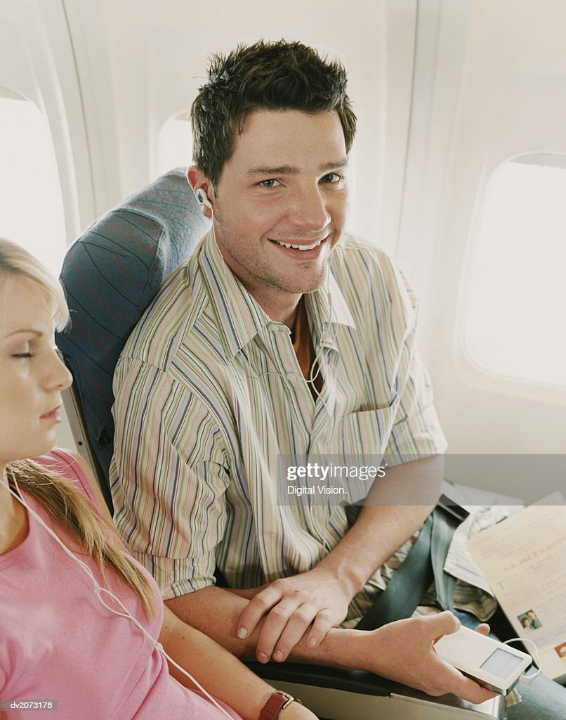 Man Sitting with a Woman on a Plane : Stock Photo