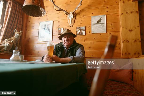 man sitting with beer in restaurant, bavaria, germany, europe - bavaria stock pictures, royalty-free photos & images