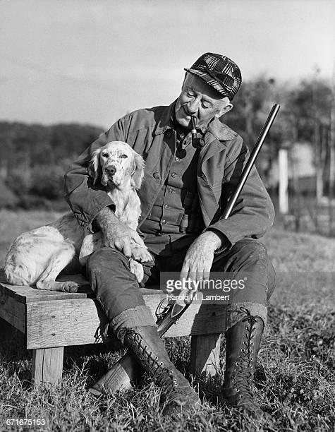 man sitting with dog and smoking   - {{relatedsearchurl(carousel.phrase)}} stock pictures, royalty-free photos & images