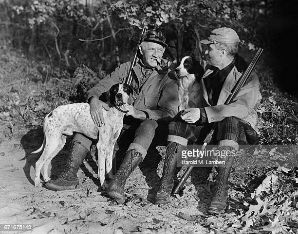 man sitting with dogs and smoking   - {{relatedsearchurl(carousel.phrase)}} stock pictures, royalty-free photos & images