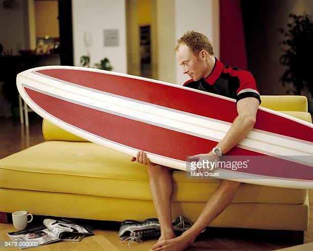 Man Sitting with Surfboard