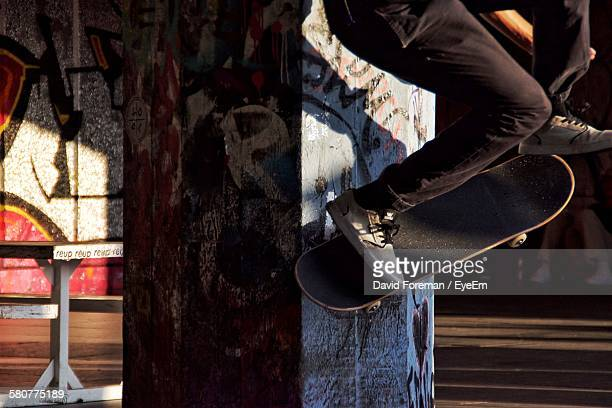 man skateboarding at street - stunt stock photos and pictures