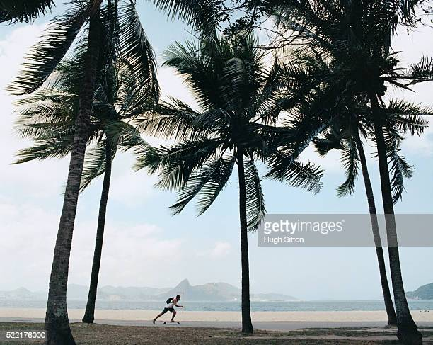man skateboarding by beach - hugh sitton stock pictures, royalty-free photos & images