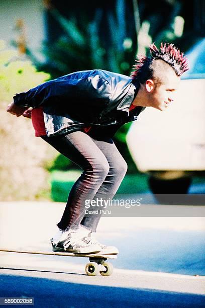 Man Skateboarding Downhill