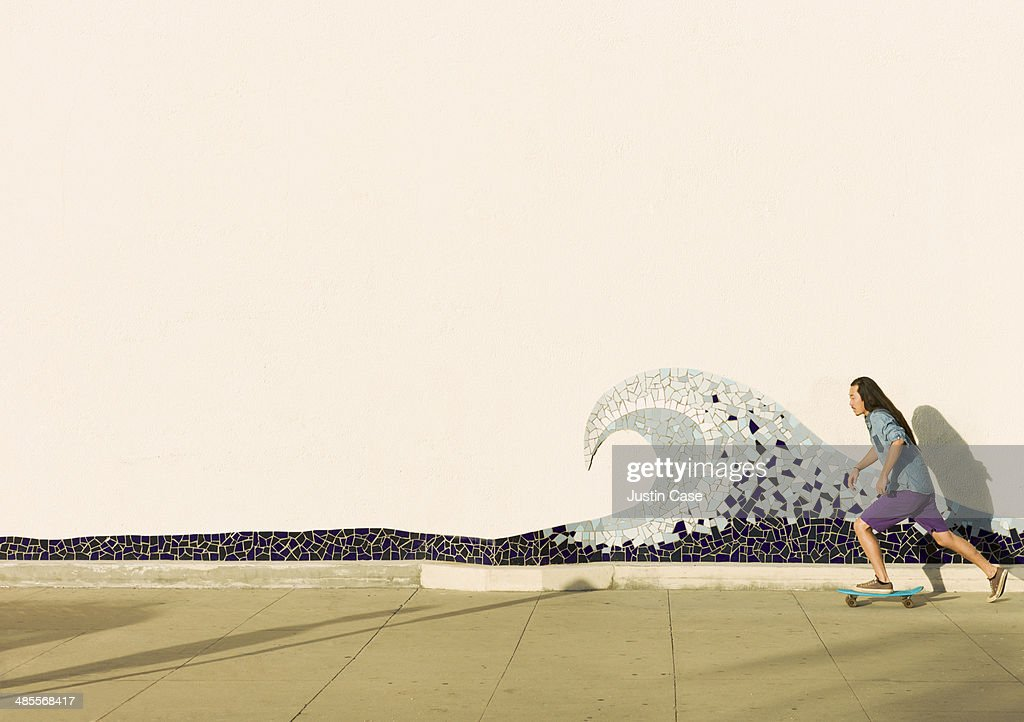 man skateboarding in front of a mosaic wave : Stock Photo