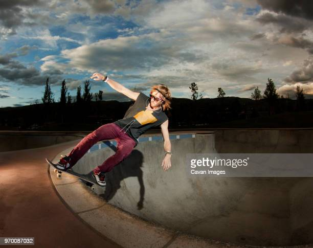 Man skateboarding in skateboard park