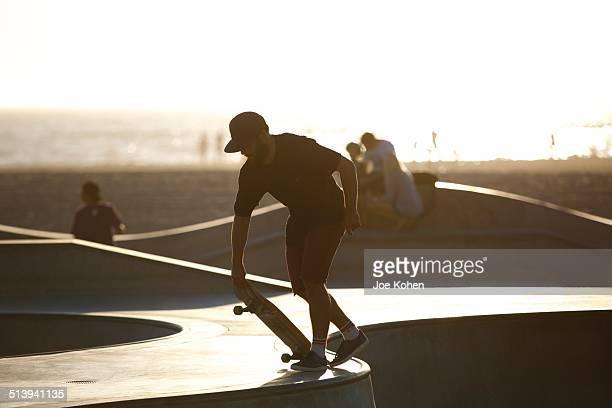 A man skateboarding in Venice beach CA on September 15 2014