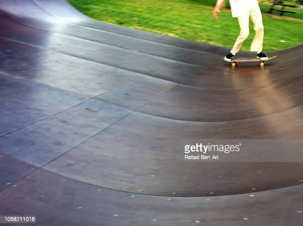 Man Skateboarding on a Skate Ramp