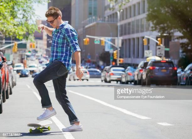 Man skateboarding on city street