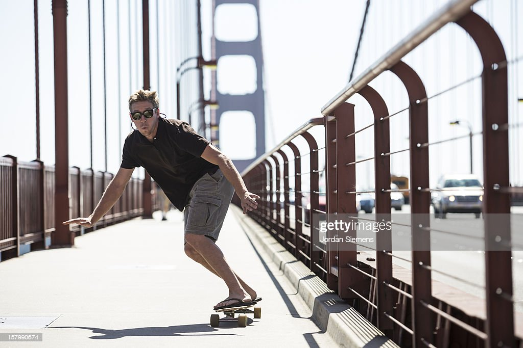 A man skateboarding on the Golden Gate. : Stock Photo