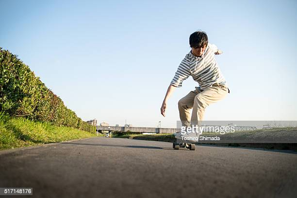 a man skateboarding - spanking adult stock photos and pictures