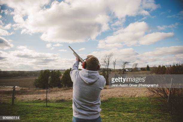 man skeet shooting - clay pigeon shooting stock pictures, royalty-free photos & images