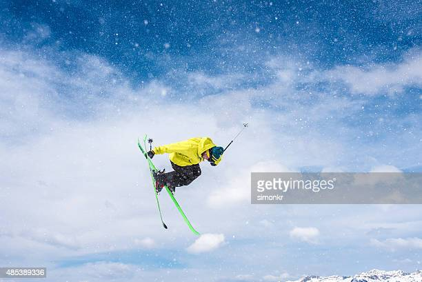 Man ski jumping in air