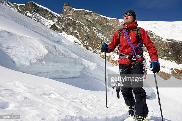 Man ski touring on snow-covered mountain, Saas Fee, Switzerland