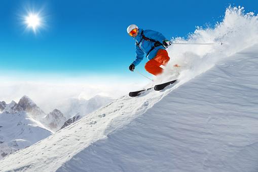 Man skier running downhill 495114582