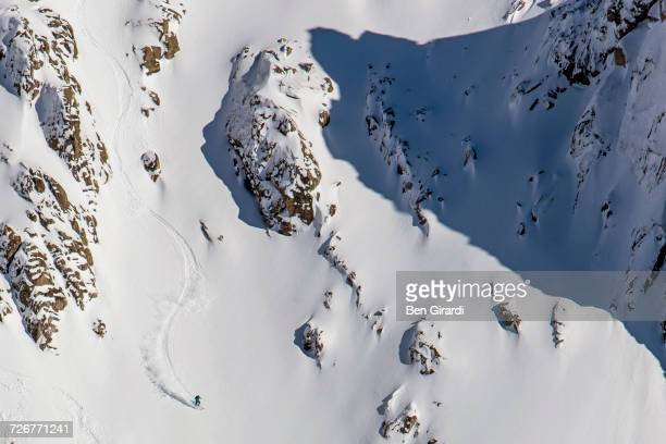 a man skiing at a big mountain line and gets fresh tracks after ski touring at a backcountry area surrounding cerro catedral in argentina - bariloche stock pictures, royalty-free photos & images