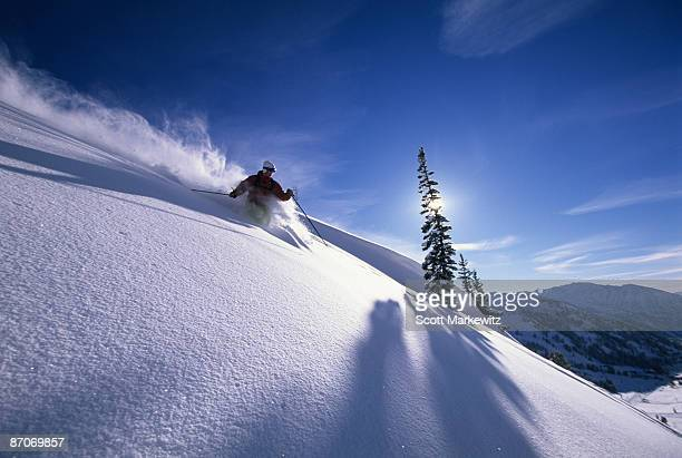 Man skiing deep powder in Utah.