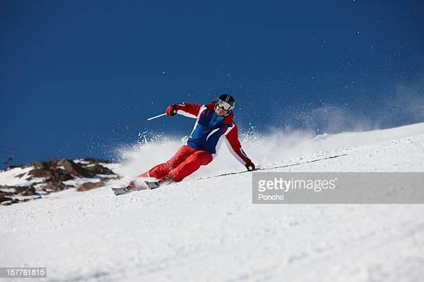 man skiing down a piste