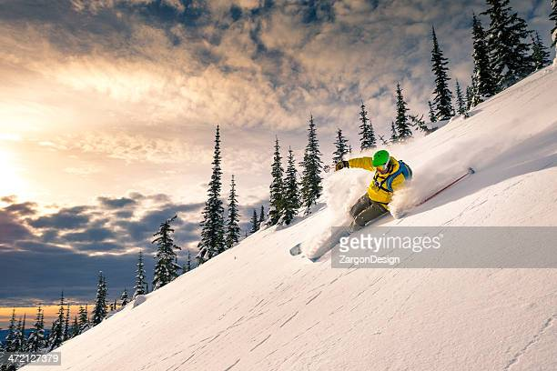 A man skiing down a powdery snow mountain