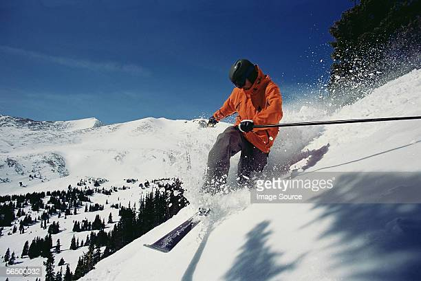 man skiing down mountainside - telemark stock pictures, royalty-free photos & images