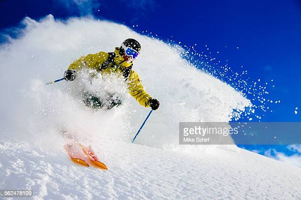 a man skiing fresh powder. alta, utah - powder snow stock pictures, royalty-free photos & images