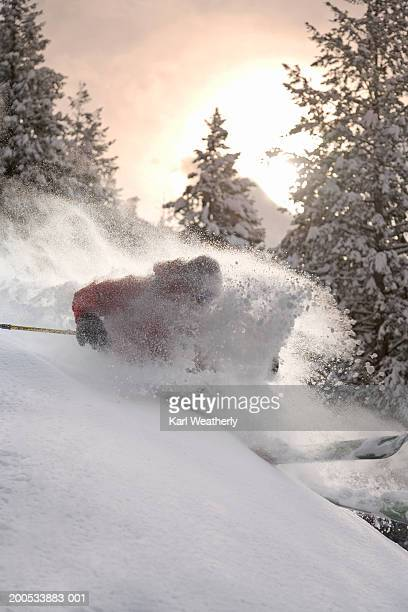 Man skiing in powder snow, side view, winter, (blurred motion)