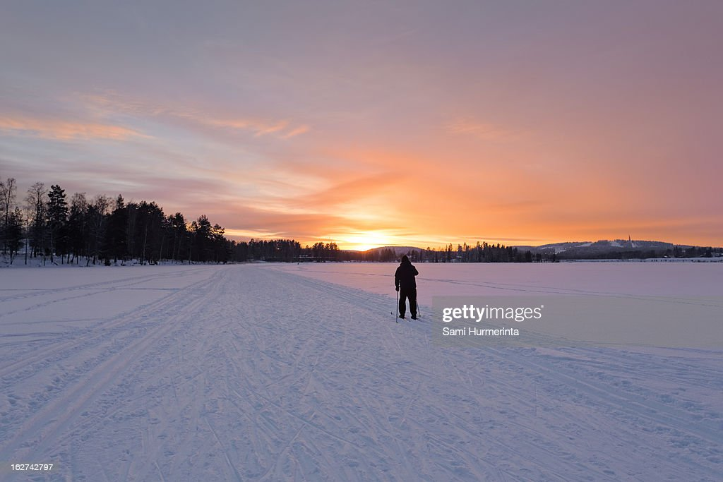 A man skiing into the sunset : Stock Photo