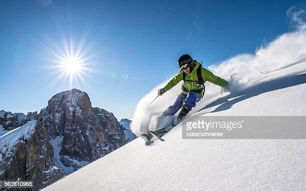 man skiing off piste, dolomites, italy - ウィンタースポーツ ストックフォトと画像