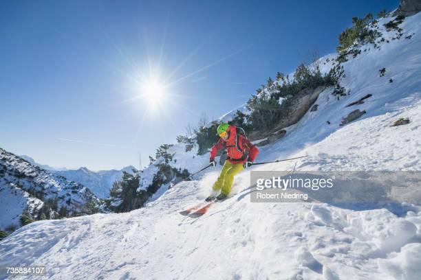 Man skiing on snowcapped mountain