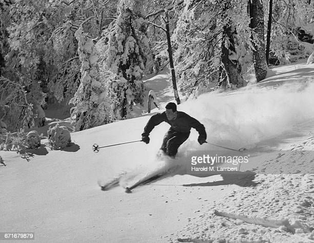 man skiing - number of people stock pictures, royalty-free photos & images