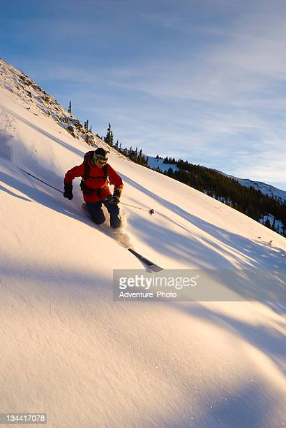 man skiing powder in colorado - telemark stock pictures, royalty-free photos & images