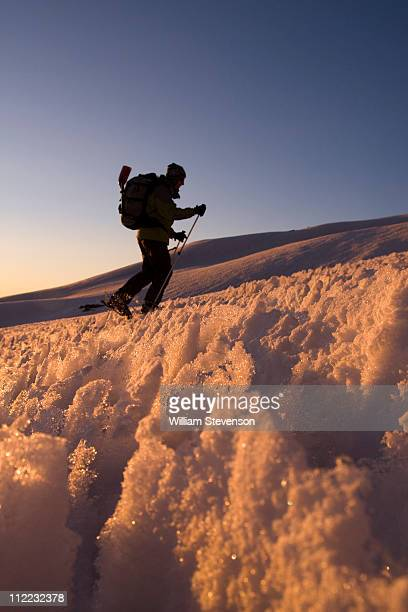 a man skiing through penitentes at sunset on volcan san jose in the andes mountains of chile - penitentes fotografías e imágenes de stock