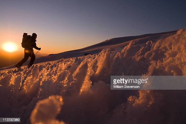 A man skiing through penitentes at sunset on Volcan San Jose in the Andes mountains of Chile