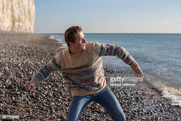 man skimming rocks on beach - pebble stock pictures, royalty-free photos & images