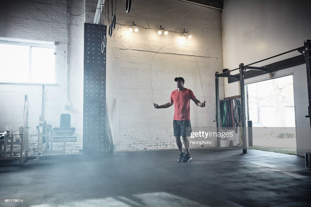 Man skipping in gym : Stock Photo