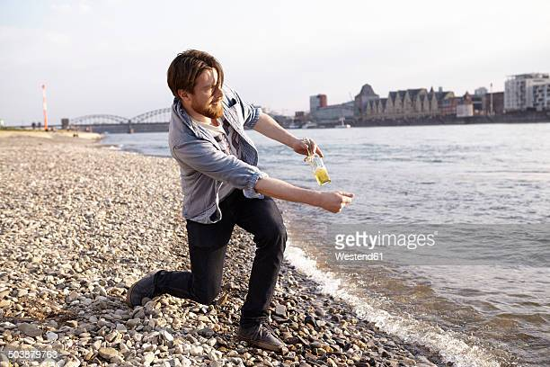 Man skipping stones at river