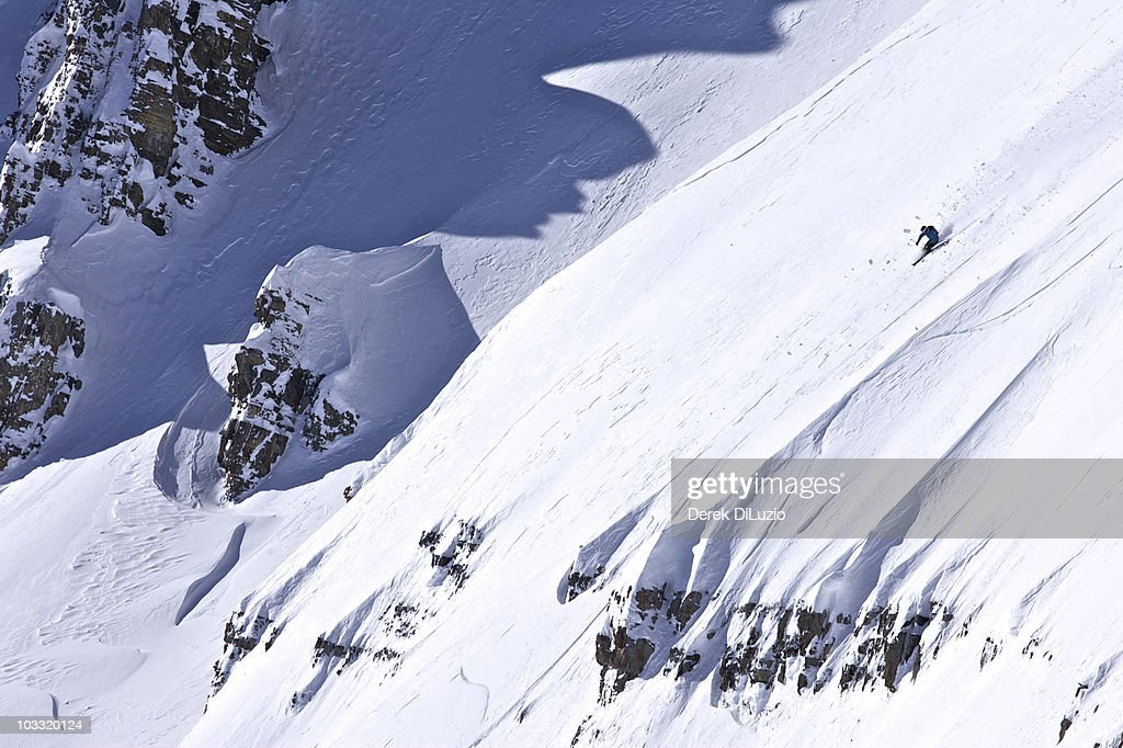 A man skis a steep line in Wyoming. : Stock Photo