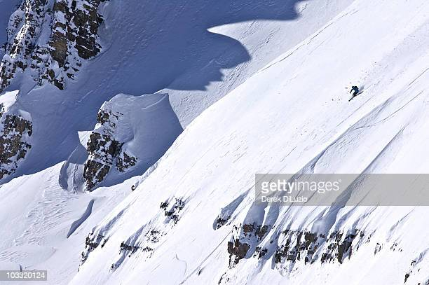 A man skis a steep line in Wyoming.