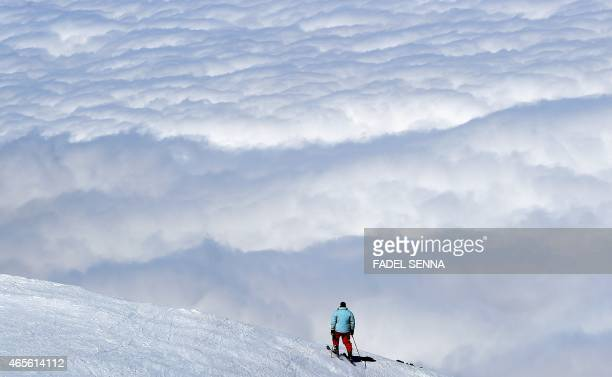 A man skis at the Oukaimeden ski resort in the Atlas Mountains 30 kilometres from the popular tourist resort of Marrakesh on February 17 2015 On a...