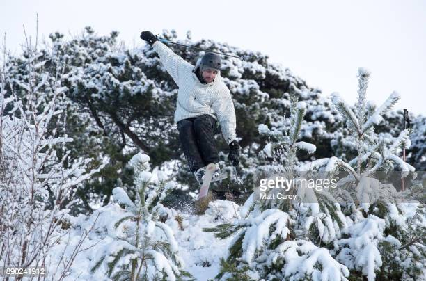 A man skis down a slope covered in snow that has covered Rodborough Common close to the town of Stroud on December 11 2017 in Gloucestershire England...