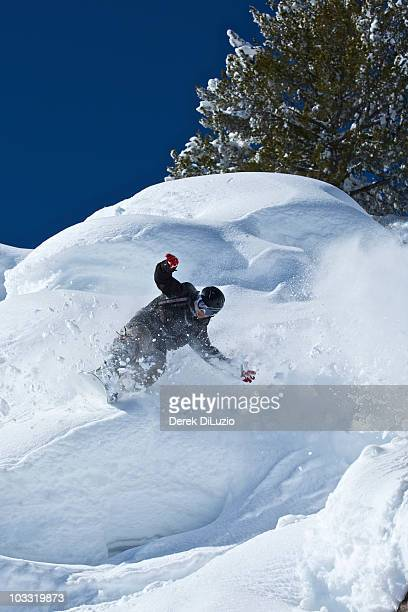 A man skis in powder snow in Wyoming.