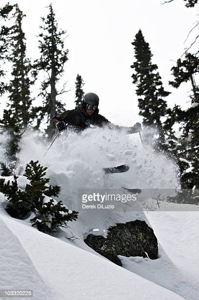 A man skis off a rock in the Wyoming.