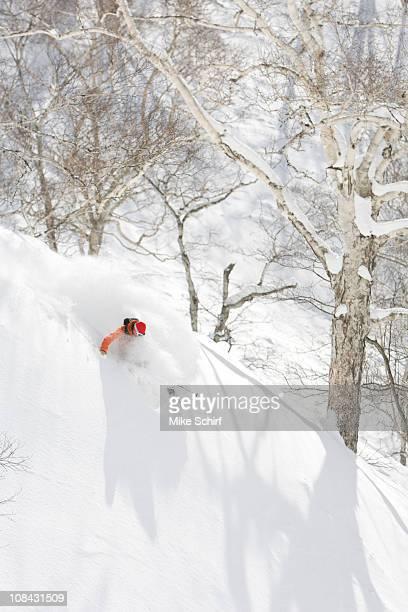 A man skis some powder in Niseko, Japan