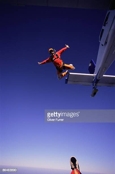 Man skydiving out of plane