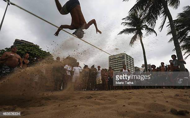 A man slacklines on Ipanema beach during Carnival festivities on February 15 2015 in Rio de Janeiro Brazil This year's official Carnival festivities...